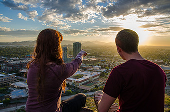 two students overlooking Tempe from A Mountain