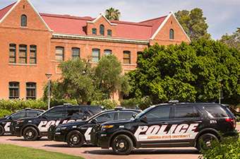 ASU Police cars in front of Old Main building
