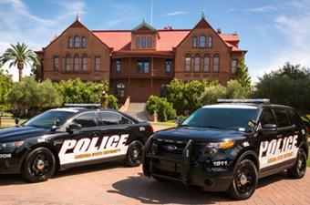 ASU Police cars parked in front of Old Main